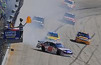 Sept. 21, 2008; Dover, DE, USA; Nascar Sprint Cup Series driver Dale Earnhardt Jr (88) spins during the Camping World RV 400 at Dover International Speedway. Mandatory Credit: Mark J. Rebilas-