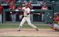 NWA Democrat-Gazette/J.T. WAMPLER Arkansas' Dominic Fletcher makes a base hit in the seventh inning to drive in Eric Cole to beat USC Sunday March 4, 2018. Arkansas won 7-6 in seven innings.