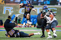 Yfat Yossifor / Standard-Times<br /> Angelo State University's Carsen Cook, center, jumps over the one of scrimmage to run the ball against Eastern New Mexico University Saturday, Sept. 24, at LeGrand Stadium.