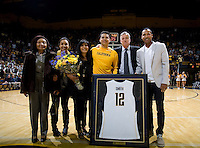 Brandon Smith of California pose together with his relatives and Coach Montgomery for group pictures before the game against Stanford at Haas Paviliion in Berkeley, California on March 6th, 2013.  Stanford defeated California, 83-70.