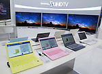 Samsung, Apr 29, 2015 : Samsung Electronics' SUHD TV sets and laptop computers (front) are displayed at Galaxy Zone, a store for display and sale of Samsung Electronics products in Seoul, South Korea. Samsung said on Wednesday its net profit plunged 39 percent in the first quarter from a year earlier because of weak earnings from mobile business, local media reported. (Photo by Lee Jae-Won/AFLO) (SOUTH KOREA)