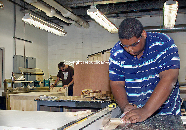 LITCHFIELD JUNE CT.-17  JUNE 2010-061710DA04- Ahkeem Barros,16 cuts a piece of wood on the table saw in the woodshop at Connecticut Junior Republic Thursday.<br /> Republican-American Darlene Douty