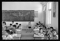 Shou County, Anhui province, China - Young students study at a government primary school, May 2017. Shou County, formerly known as Shouchun and Shouyang, was the site of the fourth capital of the former State of Chu from 241 BC.