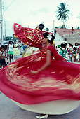 Recife, Pernambuco State, Brazil; Maracatu carnival dancer in red dress.