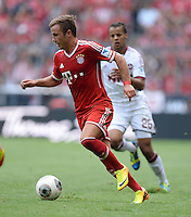 Fussball  1. Bundesliga  Saison 2013/2014  3. Spieltag FC Bayern Muenchen - 1. FC Nuernberg       24.08.2013 Mario Goetze (FC Bayern Muenchen) am Ball