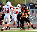 SIOUX FALLS, SD - AUGUST  28: Brock Walker #40 from Washington looks for room between Riley Bennett #22 and Matt Eigenberg #3 from Brandon Valley in the first half of their game Friday night at Howard Wood Field. (Photo by Dave Eggen/Inertia)