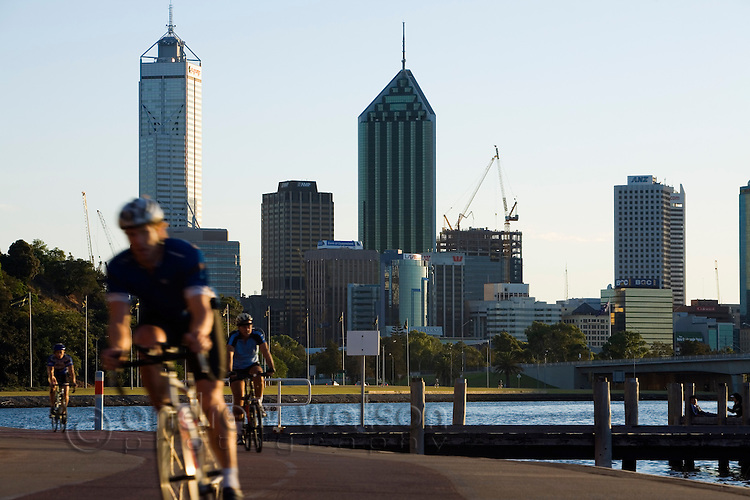 Early morning cyclists on the Perth riverside.  Perth, Western Australia, AUSTRALIA.