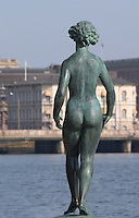In the Garden of Stadshuset, the Stockholm Town Hall. A bronze statue seen from behind naked woman by Carl Eldh Stockholm, Sweden, Sverige, Europe