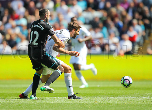 May 21st 2017, Liberty Stadium, Swansea Wales;  EPL Premier league football, Swansea versus West Bromwich Albion; Marc Wilson of West Bromwich Albion (L) and Fernando Llorente of Swansea City (R) battle for possession during the match