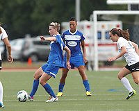 Boston Breakers midfielder Joanna Lohman (11) passes the ball as Portland Thorns FC midfielder Meleana Shim (6) closes. In a National Women's Soccer League (NWSL) match, Portland Thorns FC (white/black) defeated Boston Breakers (blue), 2-1, at Dilboy Stadium on July 21, 2013.