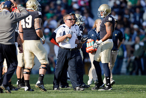 Notre Dame head coach Brian Kelly calls timeout during NCAA football game between Western Michigan and Notre Dame.  The Notre Dame Fighting Irish defeated the Western Michigan Broncos 44-20 in game at Notre Dame Stadium in South Bend, Indiana.