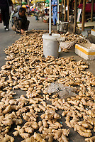 Ginger root laying on street in market, Shanghai, China