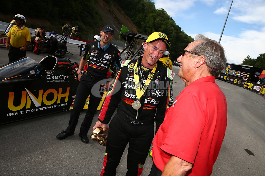 Jun 18, 2017; Bristol, TN, USA; NHRA top fuel driver Clay Millican (left) is congratulated by rival team owner Don Schumacher as he celebrates after winning the Thunder Valley Nationals at Bristol Dragway. Mandatory Credit: Mark J. Rebilas-USA TODAY Sports