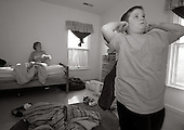 Drew 10 who is autistic, begins to show signs of being stressed, while his mother tries to balance the emotional needs of both siblings, after only a few moments in Danny's room while visiting him at Bancroft in Haddonfield, NJ on Wednesday November 15, 2006. Both McDowell boys of Souderton, Pa., are severly autistic. The ordeal at times proves too much for their parents Jill and Stacy. The decision to place Danny, who is self abusive, outside of the home was a difficult decision for the McDowell's. This was the first time both siblings have seen each other since July 6, 2006. photo by jane therese