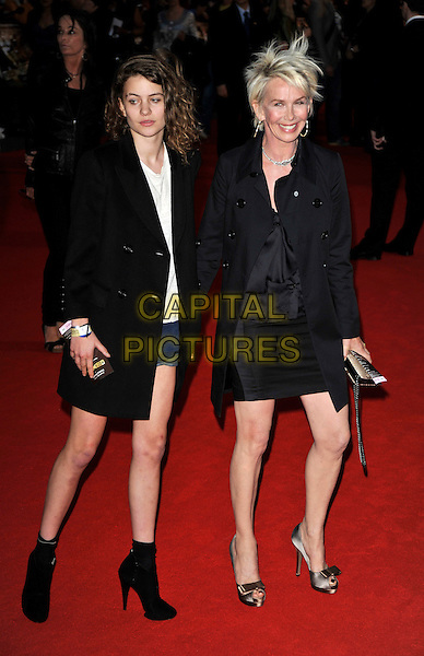 "COCO SUMNER & TRUDIE STYLER.Arrivals for the ""RocknRolla"" world film premiere held at the Odeon West End cinema, Leicester Square, London, England..September 1st, 2008.full length black coat mother daughter ankle boots shorts brown bronze satin bow shoes mom mum family .CAP/CAN.©Can Nguyen/Capital Pictures."