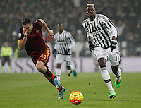 Roma's Kostas Manolas, left, andJuventus' Paul run for the ball during the Italian Serie A football match between Juventus and Roma at Juventus Stadium.
