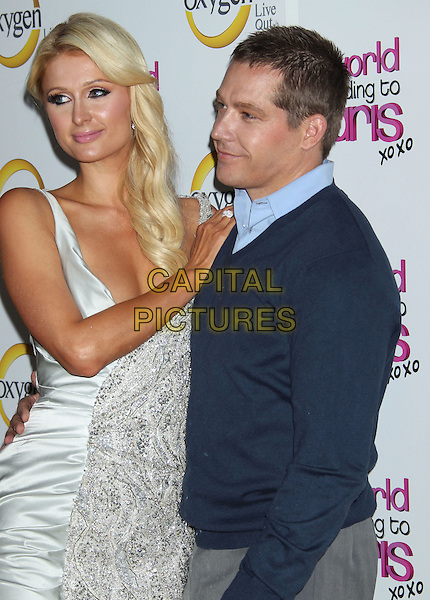 "PARIS HILTON & CY WAITS .""The World According To Paris"" Series Premiere Party Held At The Roosevelt Hotel, Hollywood, CA, USA, .17th May 2011..half length couple boyfriend blue jumper sweater  silver sleeveless  beaded tanned fake tan dress .CAP/ADM/RE.©Russ Elliot/AdMedia/Capital Pictures."