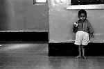 Mahadev, aged 4, son of a prostitute, standing alone in the corner of the room at the Shelter.
