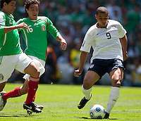 Charlie Davies shoots and scores. USA Men's National Team loses to Mexico 2-1, August 12, 2009 at Estadio Azteca, Mexico City, Mexico. .   .