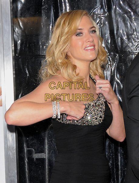 "KATE WINSLET.World Premiere of ""Revolutionary Road"" held at The Mann Village Theatre in Westwood, California, USA. .December 15th, 2008.half length dress black jewel encrusted one shoulder diamond bracelets adjusting .CAP/DVS.©Debbie VanStory/Capital Pictures."