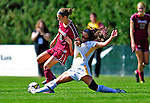 19 September 2010: University of Vermont Catamount defender Becky DeSieno, a Junior from Abington, MA, is dragged down by Colgate University Raider Maddie Malone, a Junior from Glen Ridge, NJ, at Centennial Field in Burlington, Vermont. The Raiders scored a pair of second half goals two minutes apart to notch a 2-0 victory over the Lady Cats in non-conference women's soccer play. Mandatory Credit: Ed Wolfstein Photo