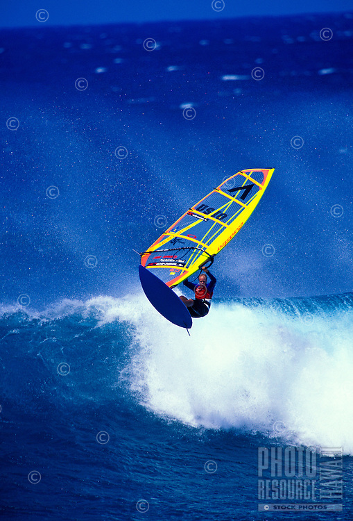 A windsurfer windsurfing at Hookipa beach park on Maui