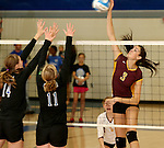 SIOUX FALLS, SD - SEPTEMBER 18: Samantha Slaughter #3 from Harrisburg looks to get a kill past Ellie Voss #14 and Amy Hurley #11 from Sioux Falls Christian in the second game of their match Thursday night at Sioux Falls Christian. (Photo by Dave Eggen/Inertia)