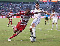 CARSON, CA – OCTOBER 24: FC Dallas midfielder Atiba Harris and LA Galaxy forward Omar Gonzalezduring a soccer match at the Home Depot Center, October 24, 2010 in Carson, California. Final score LA Galaxy 2, Dallas FC 1.