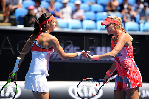 25.01.2016. Melbourne Park, Melbourne, Australia. Australian Open Tennis Championships. Start of week 2 of tournament.  Caroline Garcia (FRA) hand slides Kristina Mladenovic (FRA) in doubles