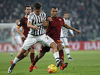 Juventus' Paulo Dybala, left, is challenged by Roma's William Vainqueur during the Italian Serie A football match between Juventus and Roma at Juventus Stadium.
