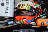 Sergio Perez of Sahara Force India F1 Team driving (11) VJM07 in the garage during second practice session of  2014 Formula 1 United States Grand Prix, Friday, October 31, 2014 in Austin, Tex. (Mo Khursheed/TFV Media via AP Images)