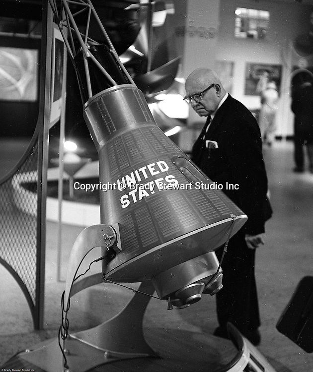 Pittsburgh PA: View of man looking at the US Steel space capsule display at Horne's department store in downtown Pittsburgh.  Steel products were displayed at Horne's during the Rhapsody of Steel campaign.  US Steel launched an awareness campaign of all the current uses of steel in everyday products.  During this time, ALCOA Aluminum Company of America also headquartered in Pittsburgh, was aggressively competing to enter markets where US  steel companies traditional dominated market share. Examples included beer and food Cans, appliances, automobile parts, children toys / bicycles, and more.