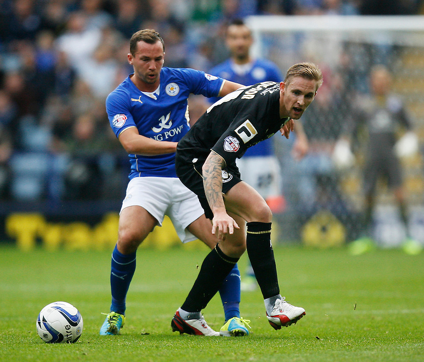 Leicester City's Daniel Drinkwater (L) and Bournemouth's Jack Collison in action during todays match  <br /> <br /> Photo by Jack Phillips/CameraSport<br /> <br /> Football - The Football League Sky Bet Championship - Leicester City v Bournemouth - Saturday 26th October 2013 - King Power Stadium - Leicester<br /> <br /> &copy; CameraSport - 43 Linden Ave. Countesthorpe. Leicester. England. LE8 5PG - Tel: +44 (0) 116 277 4147 - admin@camerasport.com - www.camerasport.com