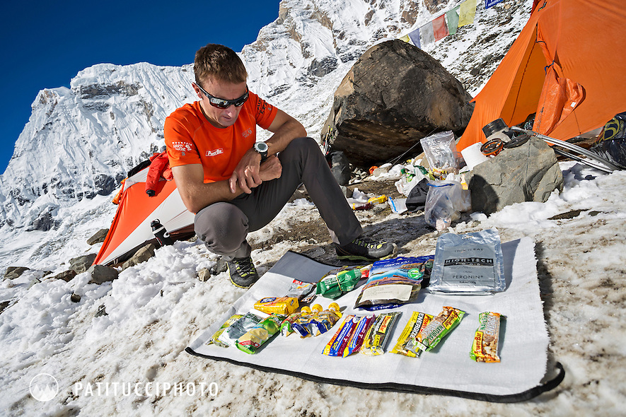 Ueli Steck returned to Nepal and the Annapurna south face in 2013 which he climbed solo, without oxygen, in one 28 hour alpine push, via a new route. The trip was his third attempt to climb the 8000 meter peak. Ueli packing and preparing his food in advance basecamp.