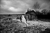 Katarzynowo, Northern Poland, December 2005<br /> The faces of Polish poverty <br /> The ex-collective farm village, forgotten by the state. People to make their living collect rubbish from the waste dump<br /> (&copy; Filip Cwik / Napo Images for Newsweek Polska)<br /> <br /> Katarzynowo k. Elku 07<br /> grudzien 2005 Polska<br /> Oblicza biedy w Polsce<br /> Katarzynowo wies w warminsko - mazurskim 20 km od Elku. Typowa po PGR-owska wies zapomniana przez panstwo. Wiekszosc mieszkancow jest bez pracy. Okoliczne wysypisko smieci jest jedynym zrodlem dochodu wiekszosci rodzin. Zbieraja puszki, gume i wszystko co ma jakakolwiek wartosc <br /> <br /> Wiekszosc Polakow niemal / 85% / z trudem radzi sobie z przezyciem od pierwszego do pierwszego. Ponad polowa / 52,5% / zalega ponad trzy miesiace z czynszem. Tyle samo osob, aby poprawic swoja sytuacje materialna radykalnie ogranicza wydatki. W beznadziejnej sytuacji jest ludnosc wiejska gdzie 18,5% zyje w skrajnej nedzy. W 1991 roku rzad polski zlikwidowal Panstwowe Gospodarstwa Rolne ktore od II Wojny Swiatowej byly miejscem pracy dla ponad 2 mln rolnikow glownie na ziemiach odzyskanych. Ci ludzie i ich rodziny nie odnalezli sie w nowej rzeczywistosci<br /> (&copy; Filip Cwik / Napo Images dla Newsweek Polska)