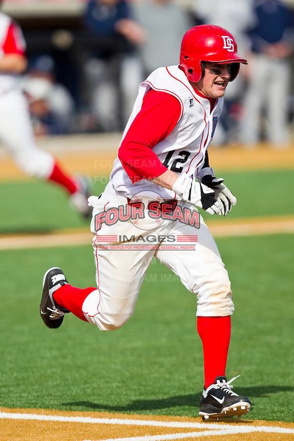Scott Davis #12 of the Delaware State Hornets hustles down the first base line against the Georgetown Hoyas at Gene Hooks Field on February 26, 2011 in Winston-Salem, North Carolina.  Photo by Brian Westerholt / Four Seam Images