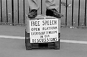 A speaker standing on a milk crate, with a sign advocating free speech, addresses a crowd at Speakers Corner, Hyde Park, London; 1993