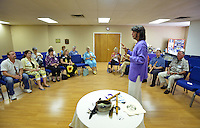 NWA Democrat-Gazette/BEN GOFF &bull; @NWABENGOFF<br /> Armand teaches basic techniques to participants on Sunday July 12, 2015 as classical crossover duo Armand and Angelina, from Orlando, Fla., lead a native american flute 'play shop' at Unity Church of the Ozarks in Bentonville. Note: the artists stated their preference is to go by just Armand and Angelina.