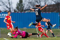 Western New York Flash goalkeeper Adrianna Franch (24) grabs a ball as Sky Blue FC forward Lisa De Vanna (11) avoids the collision. Sky Blue FC defeated the Western New York Flash 1-0 during a National Women's Soccer League (NWSL) match at Yurcak Field in Piscataway, NJ, on April 14, 2013.