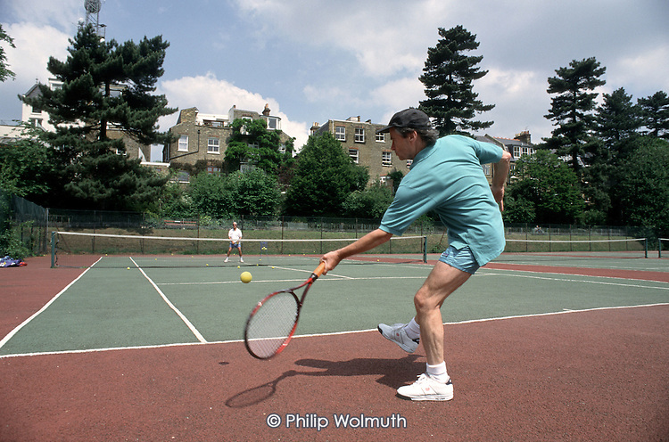 Tennis coaching on Camden Council courts at Waterlow Park, Highgate.