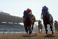 ARCADIA, CA  JUNE 23: #4 American Anthem, ridden by Mike Smith, and #2 St. Joe Bay, ridden by Tyler Baze, battle in the stretch of the San Carlos Stakes on June 23, 2018, at Santa Anita Park in Arcadia, CA.   (Photo by Casey Phillips/Eclipse Sportswire/Getty Images)