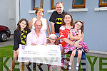 Erin O'Sullivan presented a Cheque for €5000 to William Davis, Chief Executive of AT Society on Saturday the proceeds of a Head Shave Event  in Woodies Pictured Louise O'Sullivan, William Davis, Chief Executive of AT Society, Erin O'Sullivan, Caroline O'Sullivan, Megan O'Sullivan, Lorraine O'Sullivan, Paul O'Sullivan