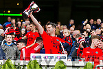 Feral Griffin Glenbeigh Glencar celebrates with his son Ross after his teams victory over Rock Saint Patricks in the Junior Football All Ireland Final in Croke Park on Sunday.