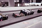 Suitcases, luggage on airport baggage claim conveyor carousel, Narita International Airport, Japan