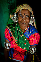 A tribal woman poses for a photograph in the Chichbardi village in the Yavatmal district in the central Indian state of Maharashtra on the 25th of March 2011.