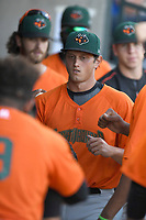 Starting pitcher Stephen Woods (22) of the Augusta GreenJackets is greeted after coming out of a game against the Columbia Fireflieon Sunday, July 30, 2017, at Spirit Communications Park in Columbia, South Carolina. Augusta won, 6-0. (Tom Priddy/Four Seam Images)