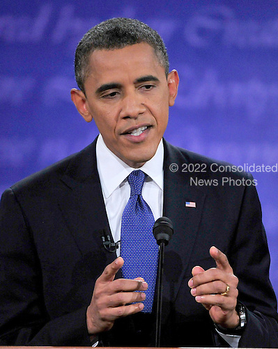 United States President Barack Obama, the Democratic Party nominee for President, makes a point as he answers a question during the first Presidential Debate of the 2012 General Election against former Massachusetts Governor Mitt Romney, the Republican Party nominee, at the University of Denver in Denver, Colorado on Tuesday, October 2, 2012..Credit: Ron Sachs / CNP.(RESTRICTION: NO New York or New Jersey Newspapers or newspapers within a 75 mile radius of New York City)