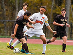 THOMASTON,  CT-101619JS07-  Terryville's Evan Coviello (16) tries to steal the ball from Thomaston's Tyler Miller (16) as the heavy rains move into the area during their Berkshire League match up Wednesday at Nystrom Park in Thomaston.<br /> Jim Shannon Republican-American