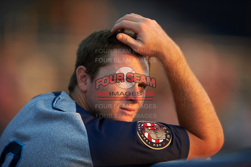Brooklyn Cyclones shortstop Dale Burdick (8) in the dugout during a game against the Batavia Muckdogs on July 5, 2016 at Dwyer Stadium in Batavia, New York.  Brooklyn defeated Batavia 5-1.  (Mike Janes/Four Seam Images)