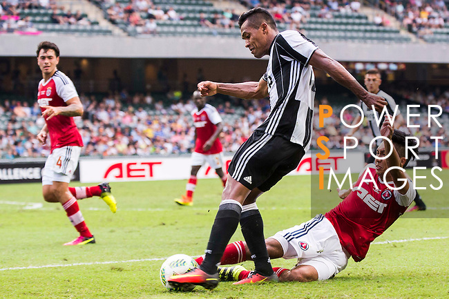 Juventus' player Alex Sandro contests the ball against South China's player Chak Ting Fung during the South China vs Juventus match of the AET International Challenge Cup on 30 July 2016 at Hong Kong Stadium, in Hong Kong, China.  Photo by Marcio Machado / Power Sport Images
